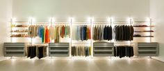 When design meets fashion! Beautiful modern open walk in closet with LED light, an aluminium modular structure, modern tough and easy to clean materials with German Blum drawers. The led light is reflected by the white glass on the wall so the walk in dressing is next to fully finished also easy to keep clean. http://dressaway.com