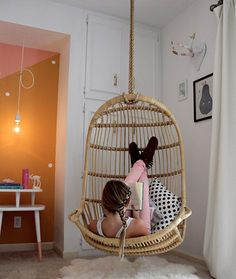This is almost identical to the hanging chair my grandparents had in their backyard in San Diego. <3 Hanging Rattan Chair by Serena & Lily