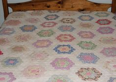 My Great Grandmother's Flower Garden Quilt made in the late 1800's using old dresses.
