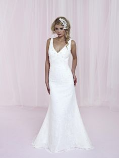 Classic... sleek... vintage... all rolled into one beautiful wedding gown