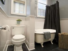 Income Property: Renovated bathroom incorporates original claw-foot tub.