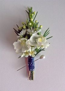wax flower, rosemary and september flower buttonhole