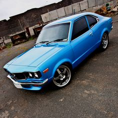 If I'm not mistaken, this is a late 70's Mazda RX3 w/the Wankel Rotary motor in it.