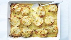 Place the onions, cut-side up, in a greased baking dish. Drizzle with the oil and sprinkle with salt and pepper. Cover with aluminum foil and bake for 1 1/2 hours. Uncover and bake for a further 15 minutes or until just starting to brown.