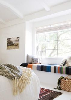 In this bright, white room, colorful stripes provide a bold accent on this window seat for lazy afternoon lounging. ON REMODELISTA: An Idyllic Guest House in Napa Valley Big Design, House Design, Design Ideas, Window Benches, Window Seats, Bay Window, Interior Exterior, Style At Home, Wabi Sabi