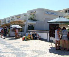 Stalls, shops and accommodation on the promenade in Praia da Luz