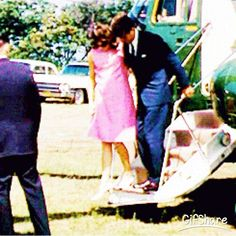 President and Mrs. Kennedy, 1963 as he was helping her off the plane after the loss of Patrick