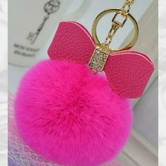 #Pink #fur #bow #pompom #gold color #keychain with #rhinestones  http://randomfindsboutique.com/products/pink-fur-pom-pom-gold-color-keychain-with-rhinestones #pompomkeychain #trending