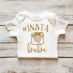 Insta Babe Sparkle Onesie in Gold Glitter and Pink Glitter. Browse our entire collection of Toddler and Baby Girl Sparkle Wear at www.shopcassidyscloset.com