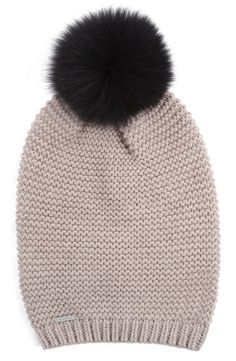 Knit with a slouchy silhouette and topped with a plush genuine fox-fur pompom, this cozy beanie evokes the perfect sense of fashionable insouciance.