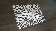 Flowerburst: This is a limited edition laser cut aluminum decorative panel in a contemporary design. Inspired by the dazzling petals of the chrysanthemum, this panel adds a bold feature. This forms an excellent focal point of any room. It can be installed tight to a wall or offset as
