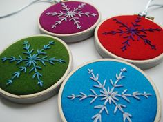 Four hand-embroidered snowflakes on pure wool felt shown in aqua, green, magenta & red (other color options available - see last frame - orange, citrine