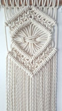 Classic macrame with a twist...  Made with 8mm rope this peice is chunky.   Wodden supporting dowel is hand finished with a beeswax based stain.  Please allow 7-14 days for completion of your peice.  #Dimensions- approximations as this is made to order#  From top supporting dowel to bottom of longest part of fringe- 115cm  Width of macrame- 34cm  Width of supporting wooden dowel- 60.5cm