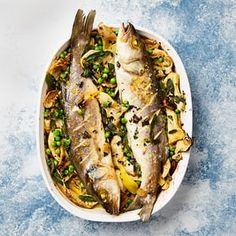 Yotam Ottolenghi's baked sea bass with artichokes and peas.