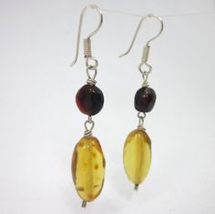 Amber Earrings, Red Amber, Women's Amber Jewelry, High Fashion Earrings by LeviathanJewelry on Etsy #womensjewelry #amberearrings #redamber