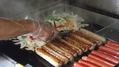 Hot dogs are near and dear to many Americans' hearts. But how you define a hot dog may differ vastly depending on whether you're in, say, New Jersey, West Virginia, or Chicago: The brand of dog, the type of bun, and everything that goes on top is likely to vary. Is the hot dog steamed or grilled? Are the buns toasted? Our list travels across the country to uncover our favorite styles of hot dog, and the best places to find them.