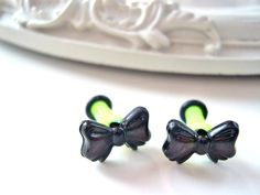 Black bow plugs for gauged ears 4mm 6g gauges stretched. $12.00, via Etsy.