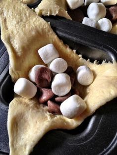 S'more Pockets: Place unrolled crescent rolls in separate muffin tins. Fill with chocolate chips/Hershey kisses, mini marshmallows, and crushed up graham crackers. Fold and pinch to close. Cook at 350 F for approx. 15 minutes.