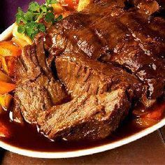 3 Envelope Roast--3 pound beef roast such as chuck roast, 1 envelope of dry Italian salad dressing mix, 1 envelope of dry ranch salad dressing mix, 1 envelope of dry brown gravy mix, 2 cups water.  Mix all and pour over roast in slow cooker.  4 hi, 8 lo