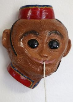 Monkey with red cap string holder