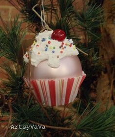 Make these cupcake ornaments from a ball ornament, baking cup, Snow Tex, seed beads, and spray berry