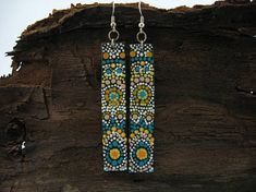 These long dangle earrings that are made from polymer clay are the perfect addition of free and wild spirit in your style. They also make a great gift for beloved friend who likes to feel unique. They would look great with your favorite jeans or summer dress. Art Spajz strongly believes that