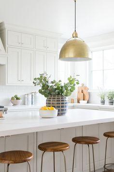 Warm, beautiful kitchen with soft white paint and warm putty cabinets, gold natural decor, kitchen styling inspiration, Kitchen pendants | Studio McGee Blog