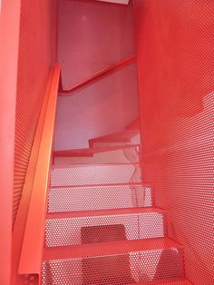 Red perforated steel floating staircase - MBA