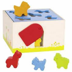 Fun animal sorting box Which animal fits through which opening? Keep trying until it fits is a great way to learn and lots of fun for little people! Then when the animals are in the box you can swing the door to the side to let them out! An lovely sorting game for little children.  wood