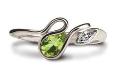 This attractive Salsa ring is made in Argentium Silver, set with a 6 x 4mm pear shaped peridot stone and a 4 x 2mm CZ marquise. The ring is available in sizes J to R and there are a variety of colourful gemstones that you can choose from.  Each ring is marked with the prestigious Britannia Silver hallmark, together with the Argentium Winged Unicorn Trademark - the guarantee of purity and quality. #Argentium #Silver Blue Topaz Stone, Peridot Stone, Garnet Stone, Garnet Rings, Blue Topaz Ring, Blue Rings, Gemstone Colors, Gemstone Rings, Keepsake Rings