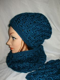 lovely pattern http://www.ravelry.com/patterns/library/hat-with-cable--eyelet-design---slouch-or-beanie