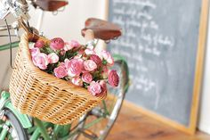 A lovely bicycle with a basket of flowers