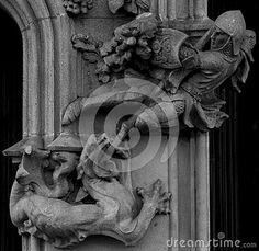 Shot in black and white, detail on an sculpture representing Saint George killing the dragon placed on the facade of this historic building Casa Ametller, set in Eixample, Barcelona, Catalunya, catalonia, España, Spain, Europe, Europa