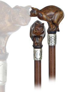 Cat Day Cane-Ca. 1920-Boxwood handle carved with a charming cat portrait, rosewood shaft with a silver collar and a brass ferrule