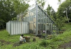 This transparent live-work structure is a giant greenhouse that accommodates people and plants. Created by Hiroshi Iguchi, the sustainable design doesn't sacrifice style. Warm, natural materials are used throughout, along with traditional Japanese panels and canvas drapes to protect residents from the sun. Trees were incorporated into the architecture, growing between the walls of the house.