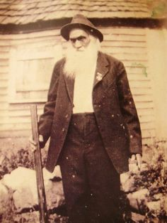 A Confederate Veteran posing with the gun he carried in battle and wearing a Confederate Veteran medal pinned to his jacket in the early 1920's. He was later buried with both. In Pulaski, Va.