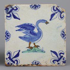 A Dutch Delft polychrome tile with a swan, 17th C.