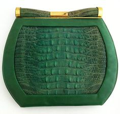 Art Deco Saks Green Lizard Purse USA Vintage Art Deco green purse by Saks Fifth Avenue. Leather, brass, and lizard skin. Beautiful cylindrical clasp accented with brass, and small interior change purse. Vintage Purses, Vintage Bags, Vintage Handbags, Vintage Shoes, Vintage Accessories, Vintage Outfits, Vintage Fashion, 1950s Fashion, Pierre Balmain