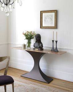 Capricorn console table in bronze with marble  top. http://www.tomfaulkner.co.uk/