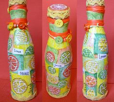 Painted lemons, oranges and limes on the bottle or fresh juice in the bottle - summer mood