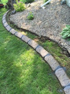 Landscape edging installed to finish off landscaping Landscape Edging Borders, Landscape Curbing, Stepping Stones, Landscaping, Sidewalk, It Is Finished, Garden, Outdoor Decor, Stair Risers