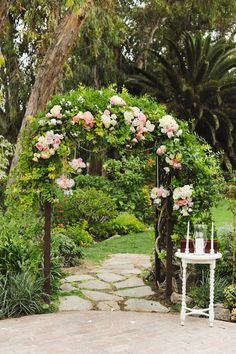 floral wedding arch http://www.weddingchicks.com/2013/10/28/vintage-wedding/