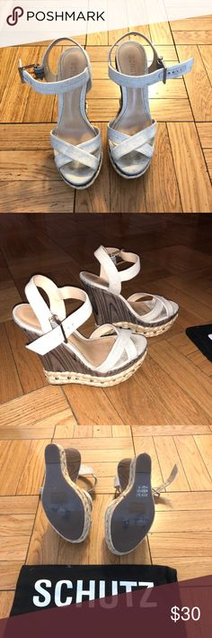 Cute tan and wooden wedges Schutz tan canvas wedges with wooden wedge and silver gromets on the bottom edges. Very cute. Good condition. SCHUTZ Shoes Wedges