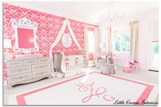 This baby girl nursery is fabulously decadent! We love the pink accent wall. #nursery #pink