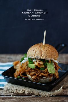 Slow Cooker Korean Chicken Sliders with gochujang aioli, avocado, kimchi, and pickled bean sprouts by @sharedappetite.  Perfect for game day, easy entertaining, and a gluten-free option!