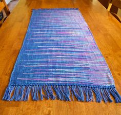 Clasped weft table runner on rigid heddle loom, hand dyed cotton.