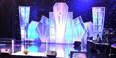 Stage design, looks like shards of ice, could be frame and tension fabric.