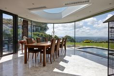 A Dining Room Extension incorporating curved glass, a shaped rooflight and a zinc roof. The concept of a samurai warrior's mask and was influenced by the client's interest in Japan. Also nicknamed Darth Vader due to the dark external materials