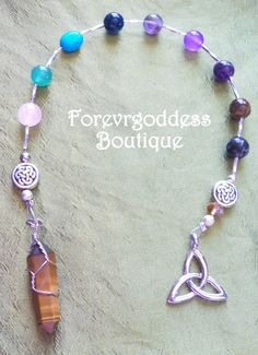 # WLTP 01  Here we have witches  ladder mixed gemstone accented  trinity symbol/tiger eye point  price $14.00+ Free ship - usa