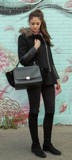 Céline Trapeze in black with suede wings. A beautiful pre-owned bag now available at www.lovethatbag.ca
